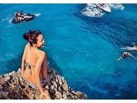 世界最棒工作台灣女孩PO墾丁船帆石跳水照 違法被抓包