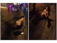 喝醉討抱!丁字褲女「裸趴」上海街頭 晃奶抬腿強吻路人