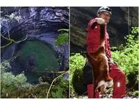 「飛貓」困底旁伴6具屍骨… 探險隊降天坑背起牠放生