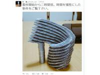 堆疊迴旋「硬幣塔」 結合酒杯牙籤造「金錢王國」