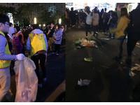 跨年散場後...北市府前滿是垃圾 學生志工彎腰默默檢