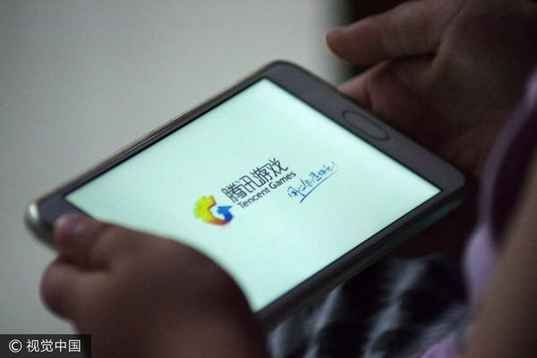 ▲騰訊旗下手機遊戲《王者榮耀》近日遭人民網批評荼毒兒童。(圖/CFP)