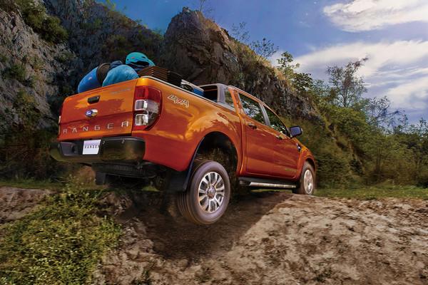 福特皮卡硬漢Ranger再創銷售紀錄 亞太妹子都愛肌肉男(圖/翻攝自Ford)