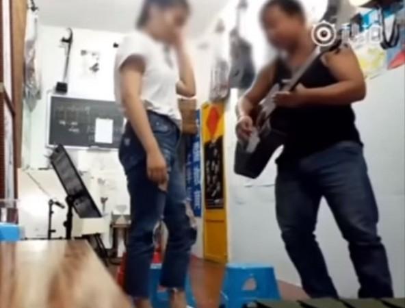 ▲17歲妹學吉他被「揉乳吸脖」 狼師:把她當女友深愛著!。(圖/翻攝梨視頻)