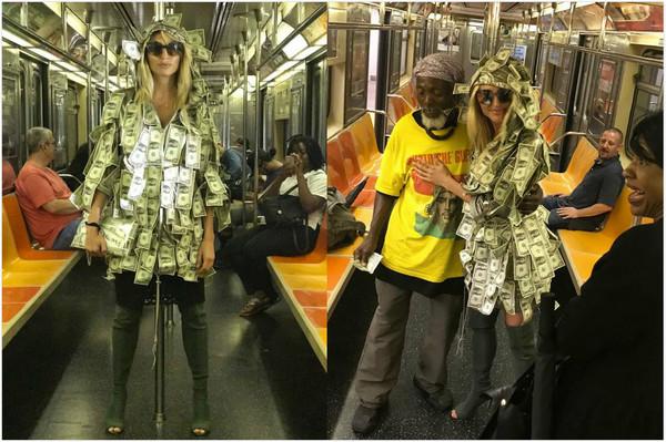 ▼女模跟接受資助的民眾拍照,打造正面形象。(圖/翻攝自IG/victoriajesusxipolitakis)
