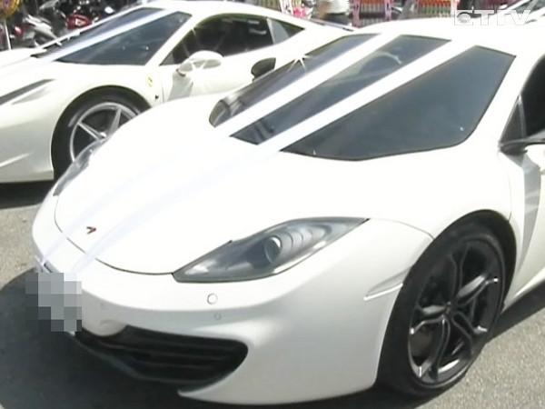 5000万元,包括有红鬃烈马法拉利、奥迪r8、f-1麦拉仑限量跑车,高清图片
