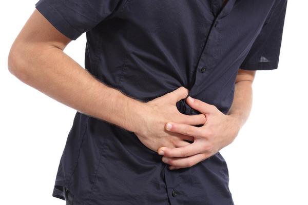 腹痛。(圖/達志/示意圖)