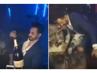耍帥開香檳卻手滑灑光「123萬」 西裝型男抱頭崩潰