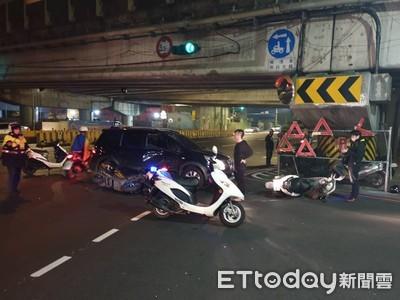 休旅車紅燈左轉突然出現 直行機車慘撞受困車底